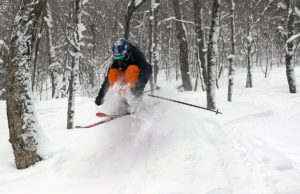 An image of Ivan jumping in powder snow at RASTA's Brandon Gap backcountry recreation area in Vermont.