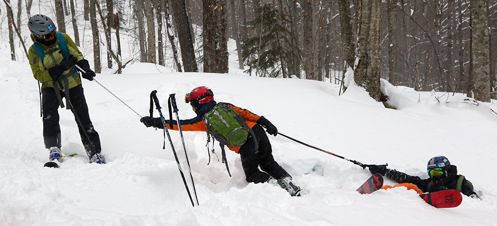 An image of Erica and Dylan helping Ivan out of the powder snow during a ski tour at the Brandon Gap Backcountry Recreation Area in Vermont