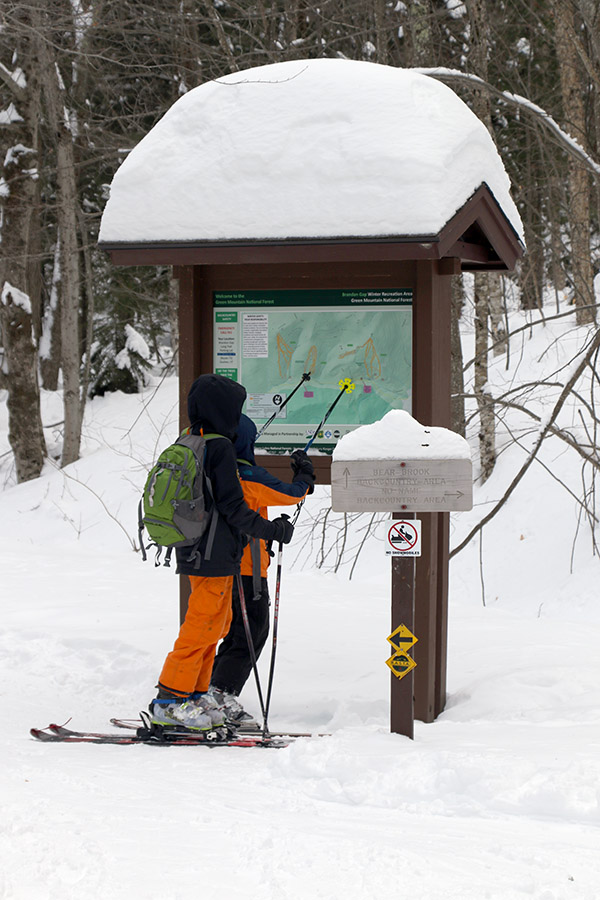 An image of Ivan and Dylan looking at the map at one of the trailheads at RASTA's Brandon Gap Backcountry Recreation Area in Vermont