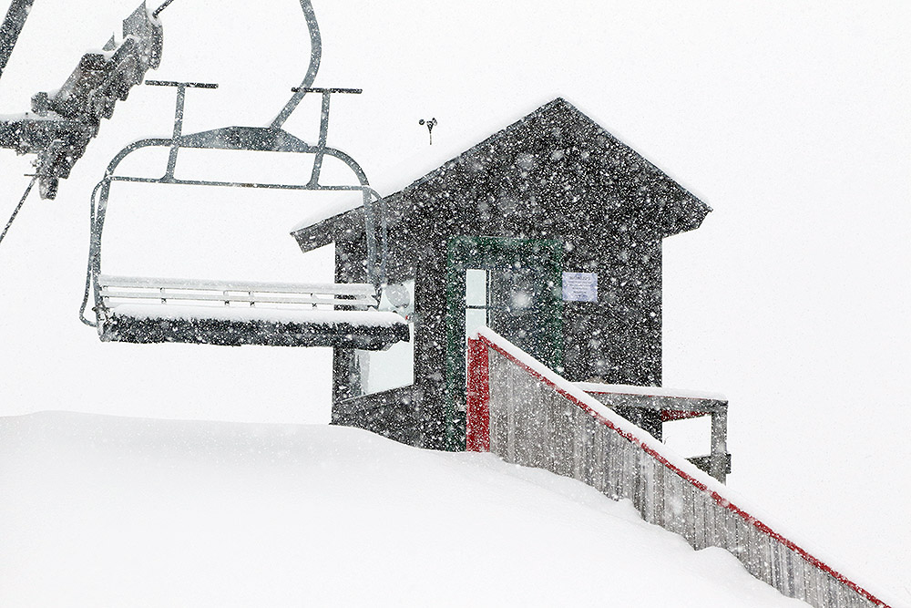 An image of heavy snowfall at the Timberline Mid Station area at Bolton Valley Ski Resort in Vermont