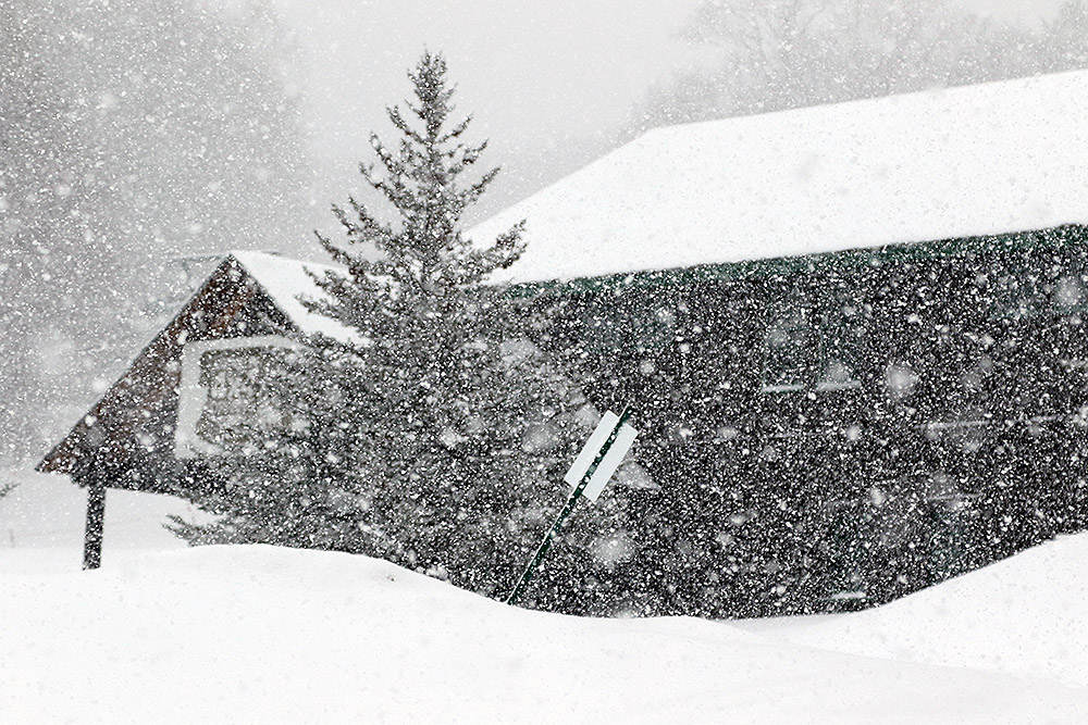 An image showing very heavy snowfall at the Timberline Base at Bolton Valley Ski Resort in Vermont