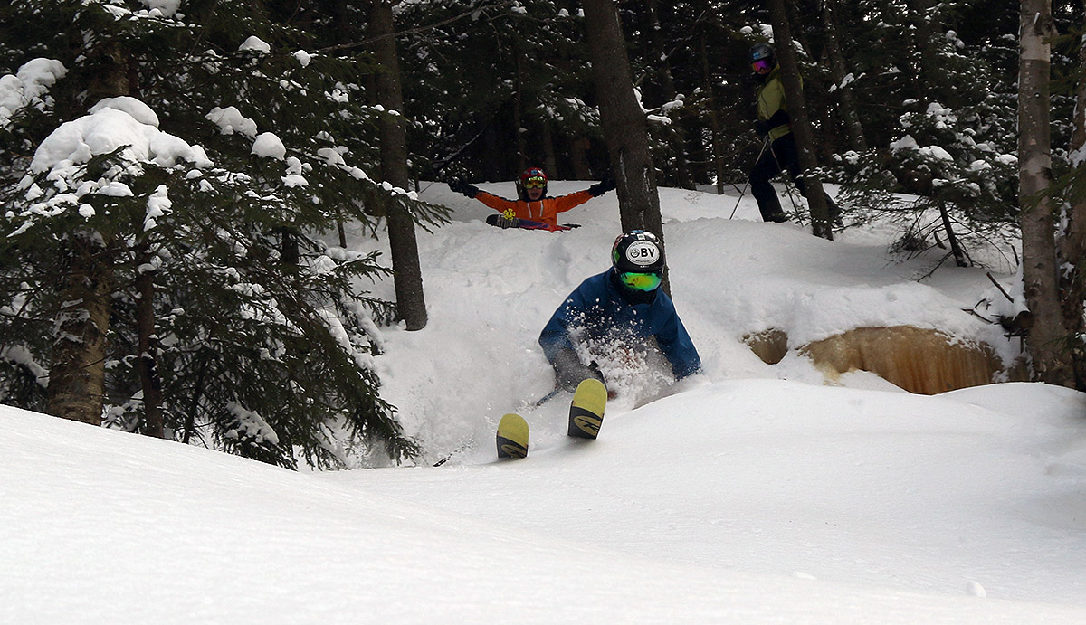 An image of Ty skiing powder with Dylan and Erica looking on in the KP Glades area at Bolton Valley Resort in Vermont