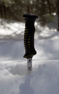 An image of a ski pole in the snowpack at Bolton Valley Ski Resort in Vermont