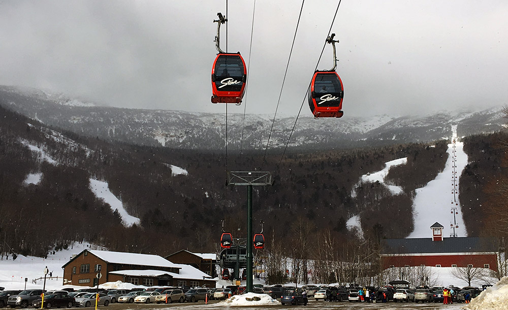 An image of the Over Easy Gondola from the Mansfield Parking Lot at Stowe Mountain Resort in Vermont