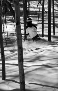 An image of Dylan skiing powder snow in the Snow Hole area at Bolton Valley Resort in Vermont