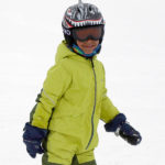 Adrian dressed in his ski gear and smiling at Stowe Mountain Resort in Vermont