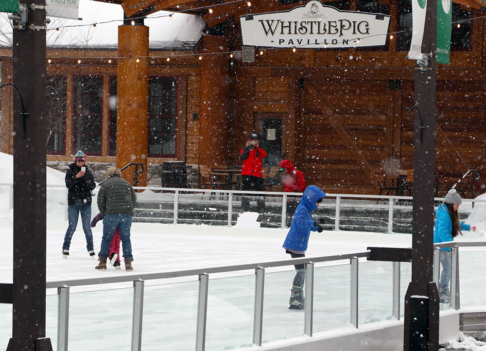 An image of snowfall from Winter Storm Taylor at the skating rink in the Spruce Peak Village at Stowe Mountain Ski Resort in Vermont