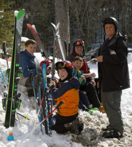 An image of a group of skiers by the Notchbrook Convenience Store having just completed a run of the Bruce Trail near Stowe Mountain Resort in Vermont