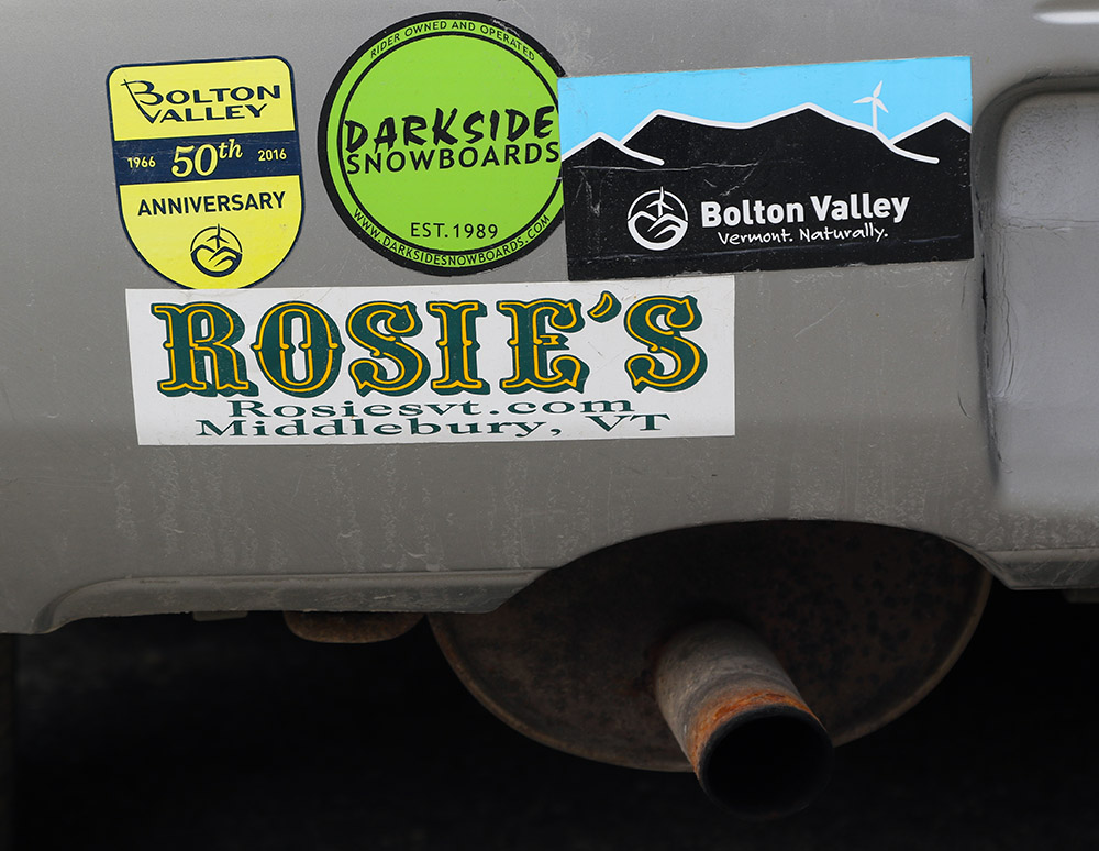 An image of some bumper stickers on a car in the Timberline parking lot at Bolton Valley Ski Resort in Vermont