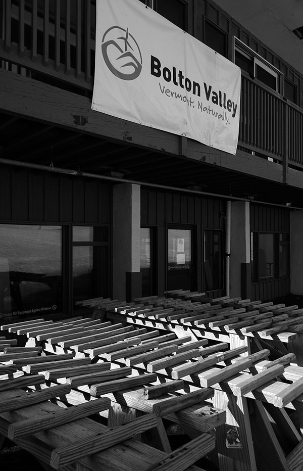 An image of ski racks stacked up behind the main base lodge at Bolton Valley Ski Resort in Vermont