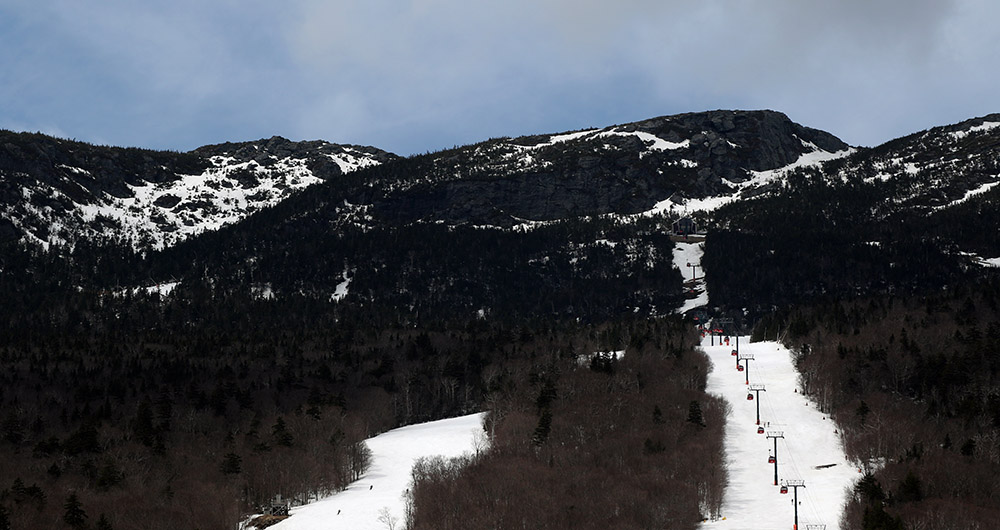 An image from Stowe Mountain Ski Resort in Vermont showing a view of the Gondola and the Mt. Mansfield ridgeline with the Rock Garden area visible in the upper left