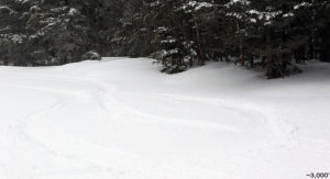An image of ski tracks in powder snow on the Perry Merrill trail at Stowe Mountain Resort in Vermont after a late April snowfall