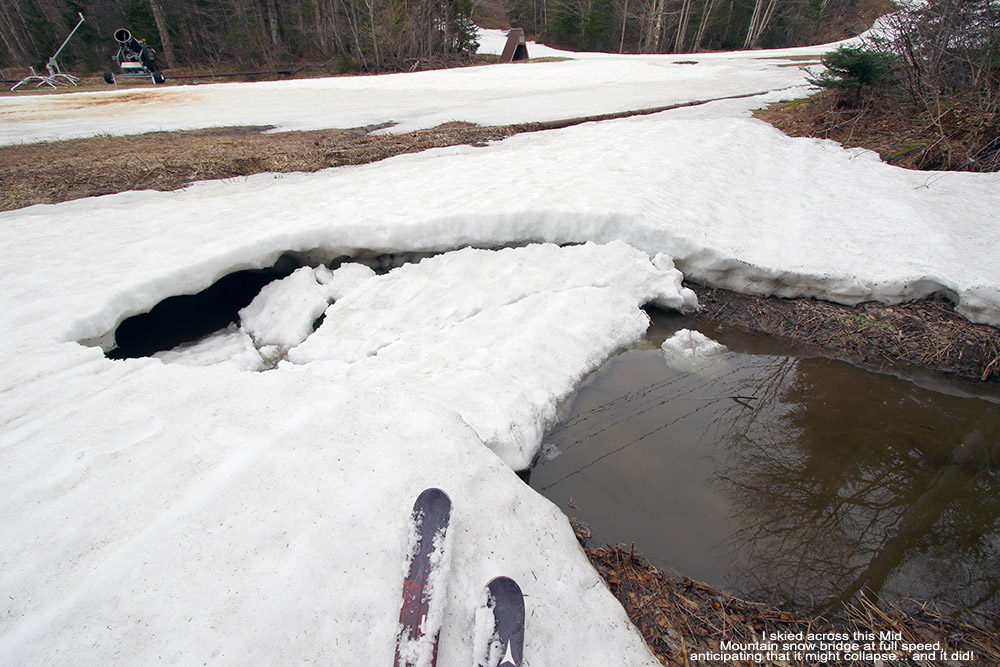 An image showing a collapsed snow bridge in May in the mid mountain area of Bolton Valley Ski Resort in Vermont