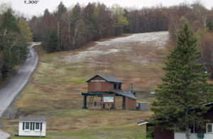 An image showing a dusting of May snow at an elevation of 1,300 feet near the base of the Toll House chairlift at Stowe Mountain Resort in Vermont