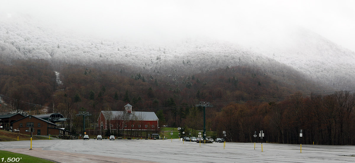 An image showing the snow line on Mt. Mansfield at the start of a ski tour in mid-May at Stowe Mountain Resort in Vermont