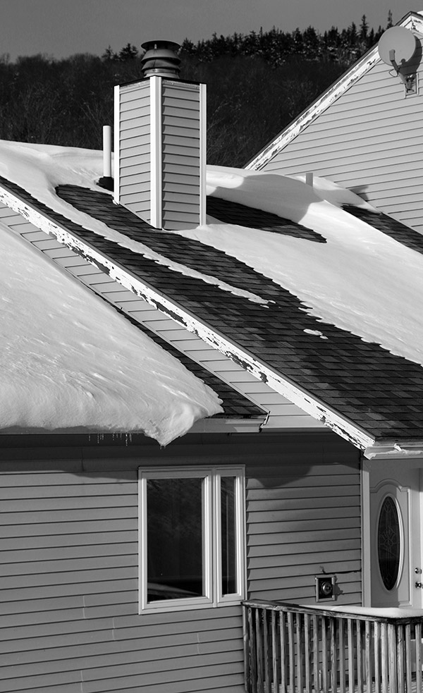An image of drifted snow atop some of the condominiums near the base of Bolton Valley Ski Resort in Vermont after an early November snowstorm