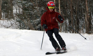 An image of Dylan skiing in the Wilderness area at Bolton Valley Resort in Vermont in mid-December after a couple of small snowfalls