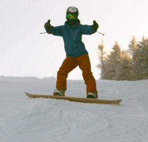 An image of Ty on his snowboard on the Alta Vista trail at Bolton Valley Resort in Vermont