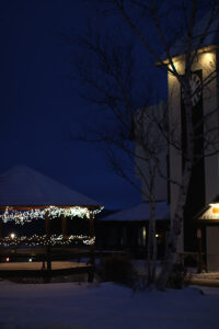 An image of holiday lights in the evening in the center of the Village at Bolton Valley Ski Resort in Vermont