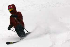 An image of Dylan Telemark skiing in powder after Winter Storm Gage at Bolton Valley Resort in Vermont