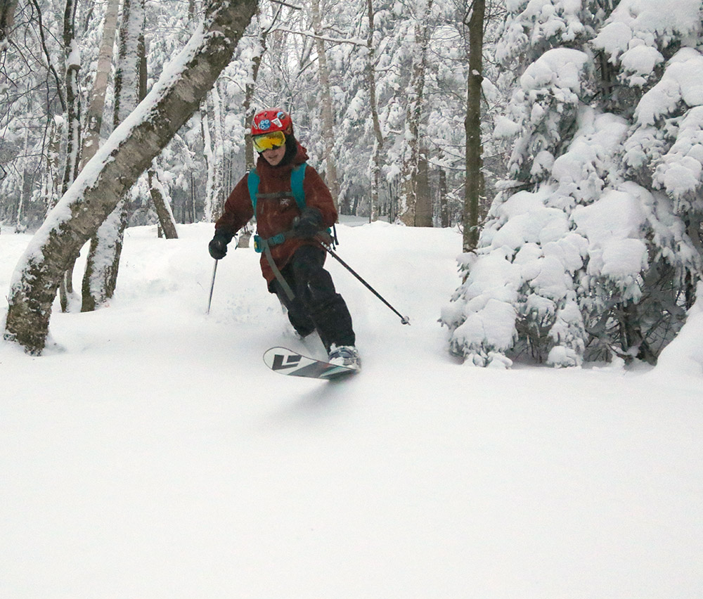 An image of Dylan Telemark skiing in some January powder on the backcountry network at Bolton Valley Resort in Vermont