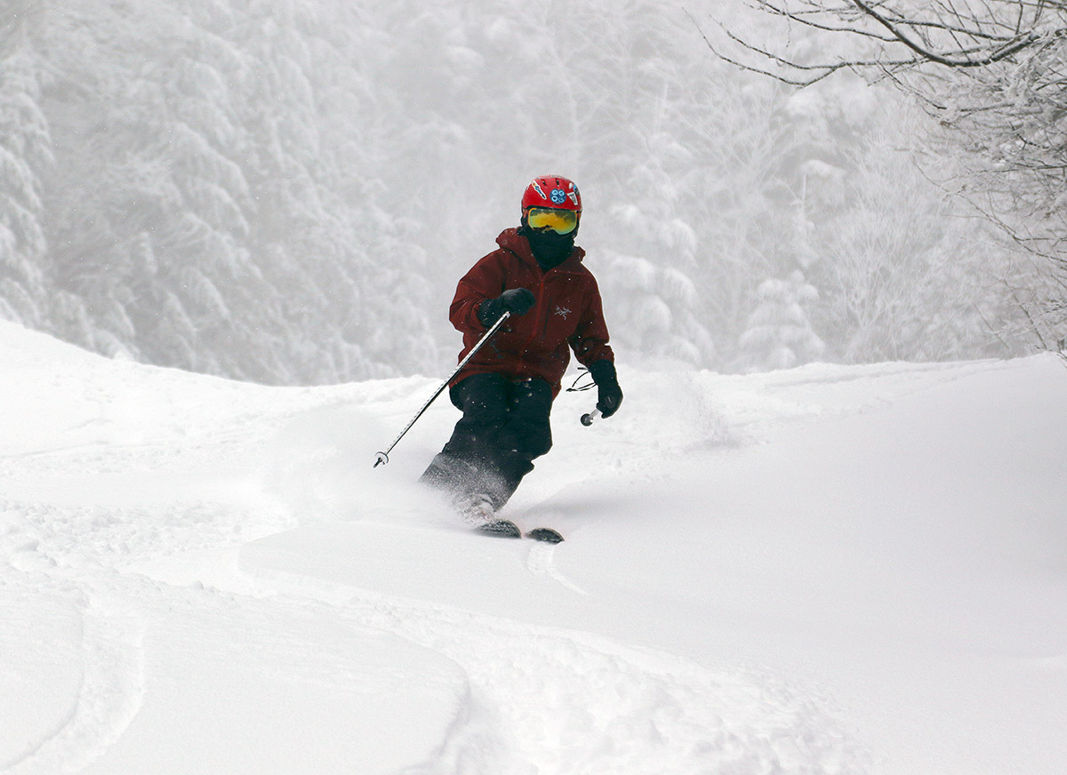 An image of Dylan skiing powder during Winter Storm Jacob in the Cobrass area at Bolton Valley Resort in Vermont
