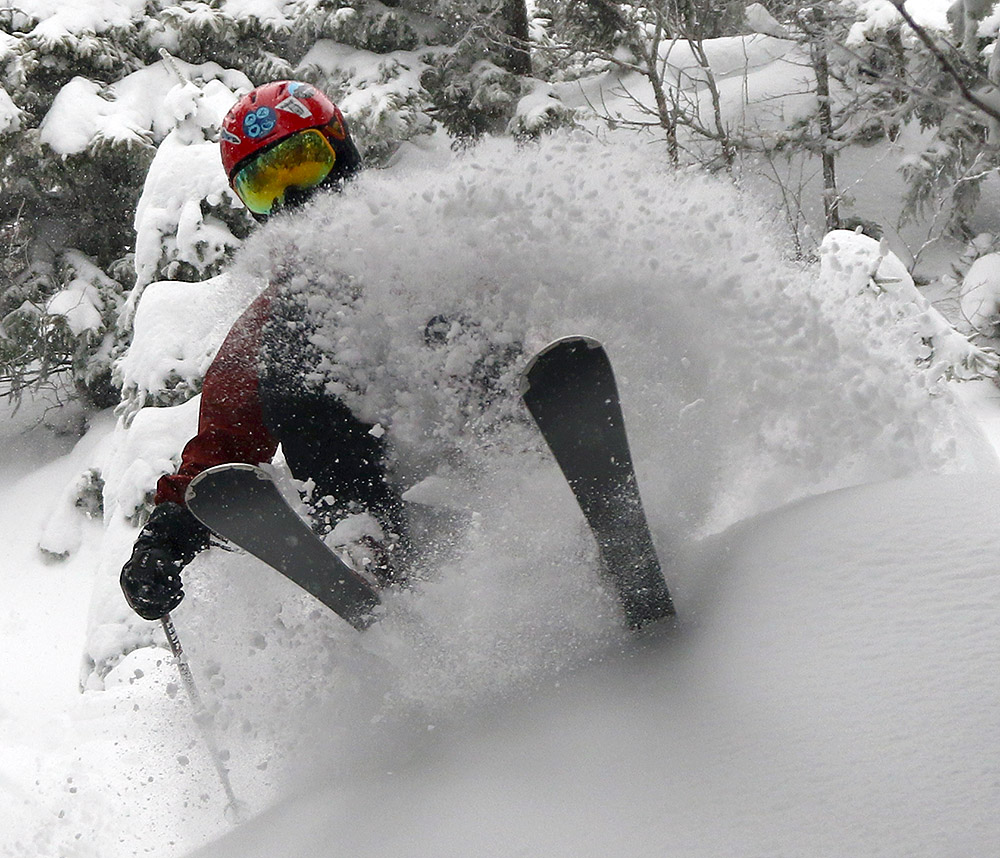 An image of Dylan blasting through powder in the Kitchen Wall area of Mt. Mansfield at Stowe Mountain Resort in Vermont