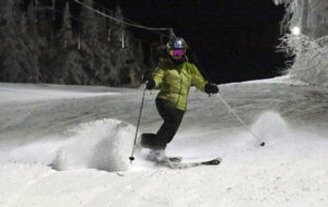 An image of Erica Telemark skiing at night at Bolton Valley Resort in Vermont