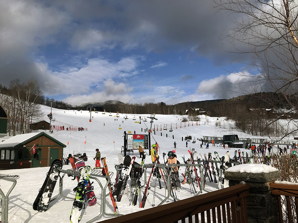 An image of a beautiful February day at the base of the Spruce Peak area at Stowe Mountain Resort in Vermont