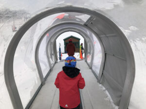 An image from inside the Magic Carpet beginner lift at Stowe Mountain Ski Resort in Vermont