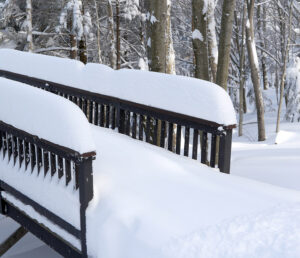An image of railings covered with fresh snow on a slopeside house at Bolton Valley Resort in Vermont after Winter Storm Kade