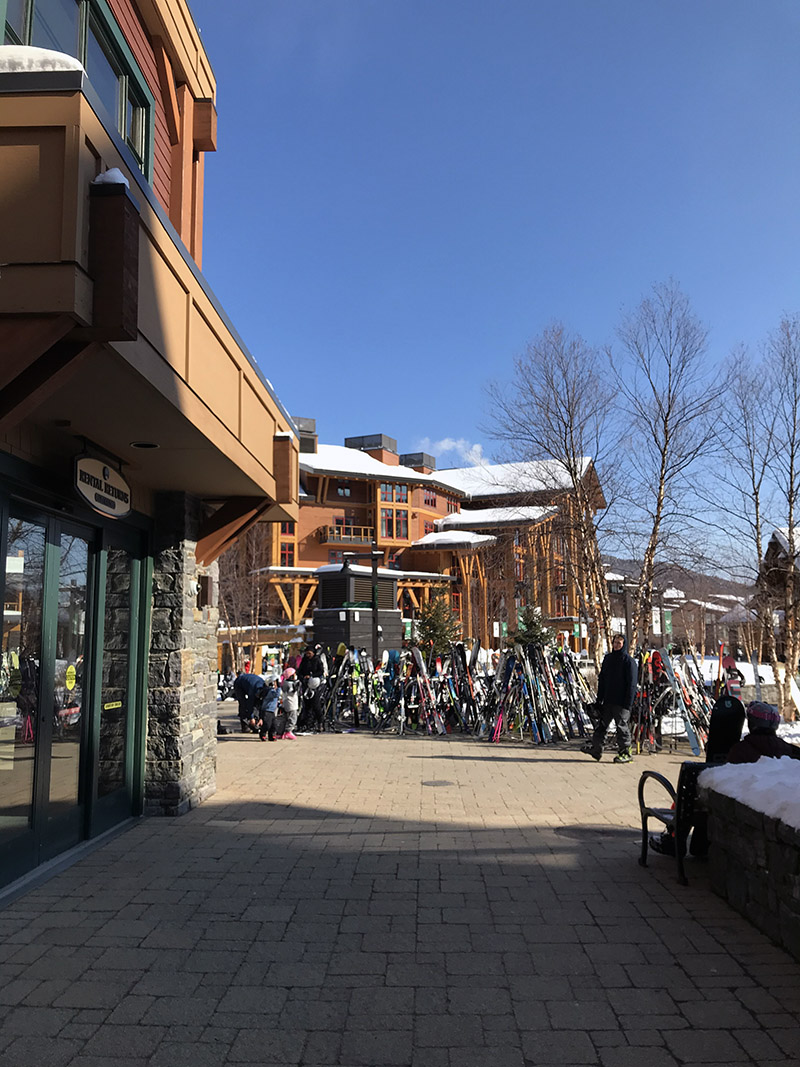 An image from the Spruce Peak Village at Stowe Mountain Ski Resort in Vermont on a sunny February day.
