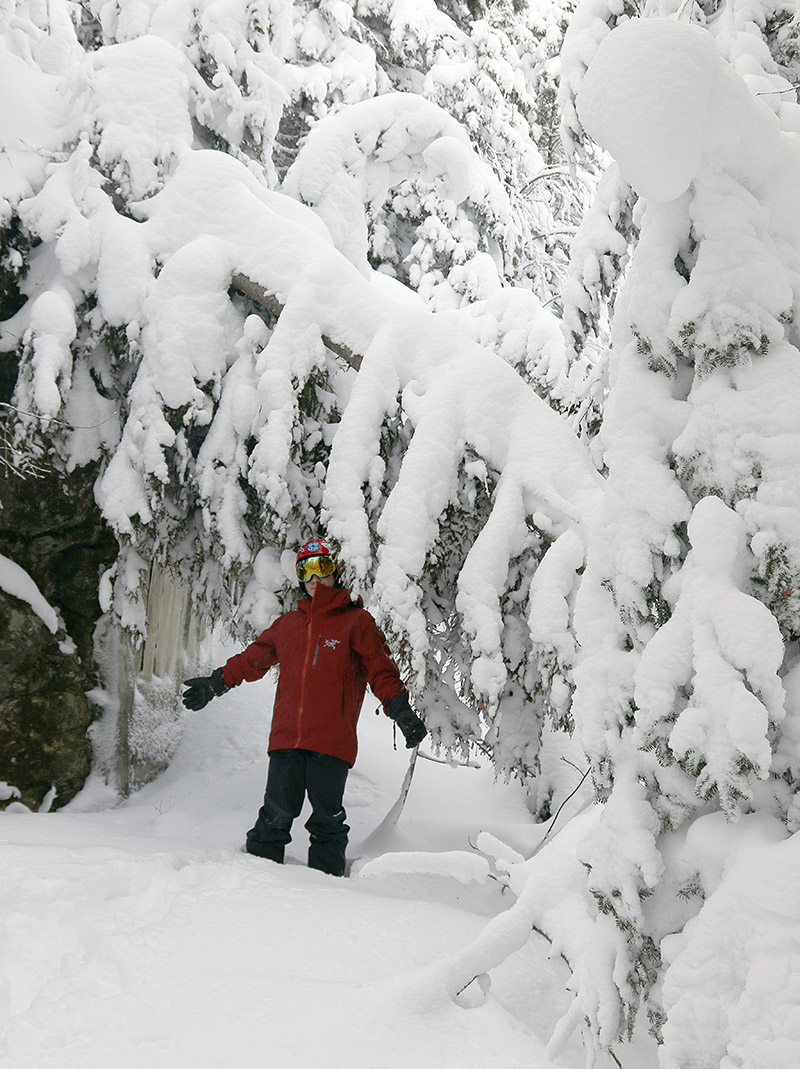 An image of Dylan in the snow laden trees off piste at Bolton Valley Ski Resort in Vermont after recent snows from Winter Storm Kade, Winter Storm Lamont, and Winter Storm Mabel.