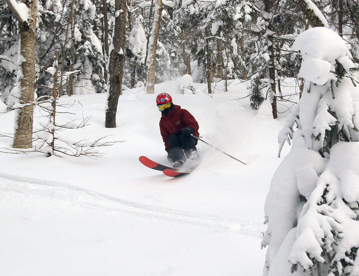 An image of Dylan skiing powder at Bolton Valley Resort in Vermont