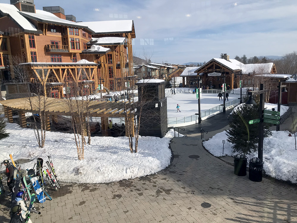An image of Spruce Peak Village and the skating rink area at Stowe Mountain Ski Resort in Vermont