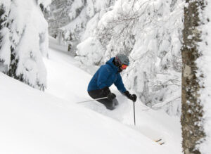An image of Erica skiing powder from Winter Storm Odell at Bolton Valley Resort in Vermont