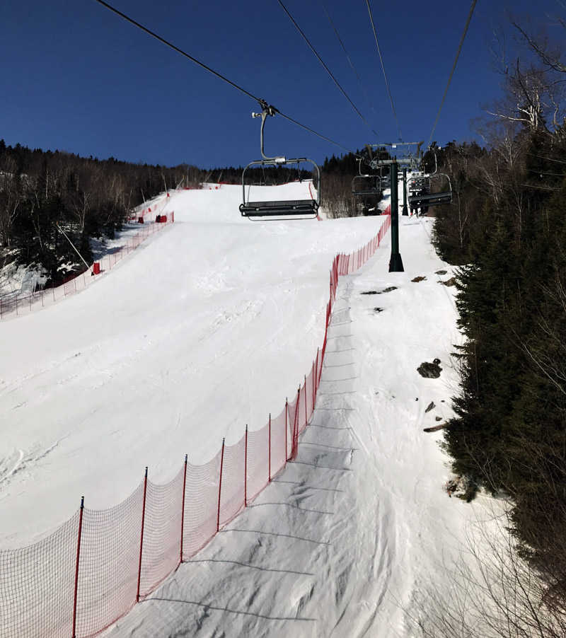 An image of the Main Street Trail set yup for racing at the Spruce Peak area of Stowe Mountain Resort in Vermont