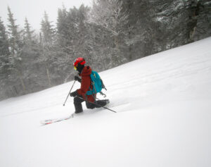 An image of Dylan Telemark skiing in powder from Winter Storm Quincy at Bolton Valley Resort in Vermont