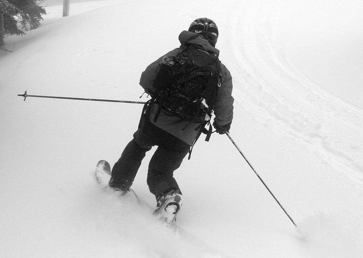 An image of Jay from behind as he Telemark skis in powder from Winter Storm Quincy at Bolton Valley Resort in Vermont