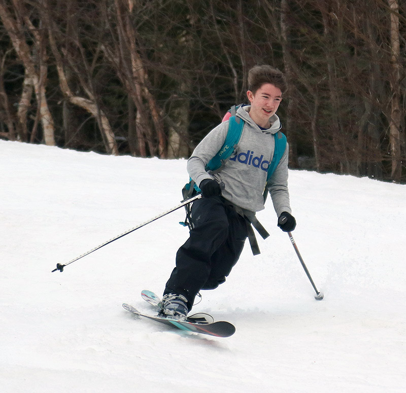 An image of Dylan Telemark skiing during a spring ski tour at Bolton Valley Resort in Vermont