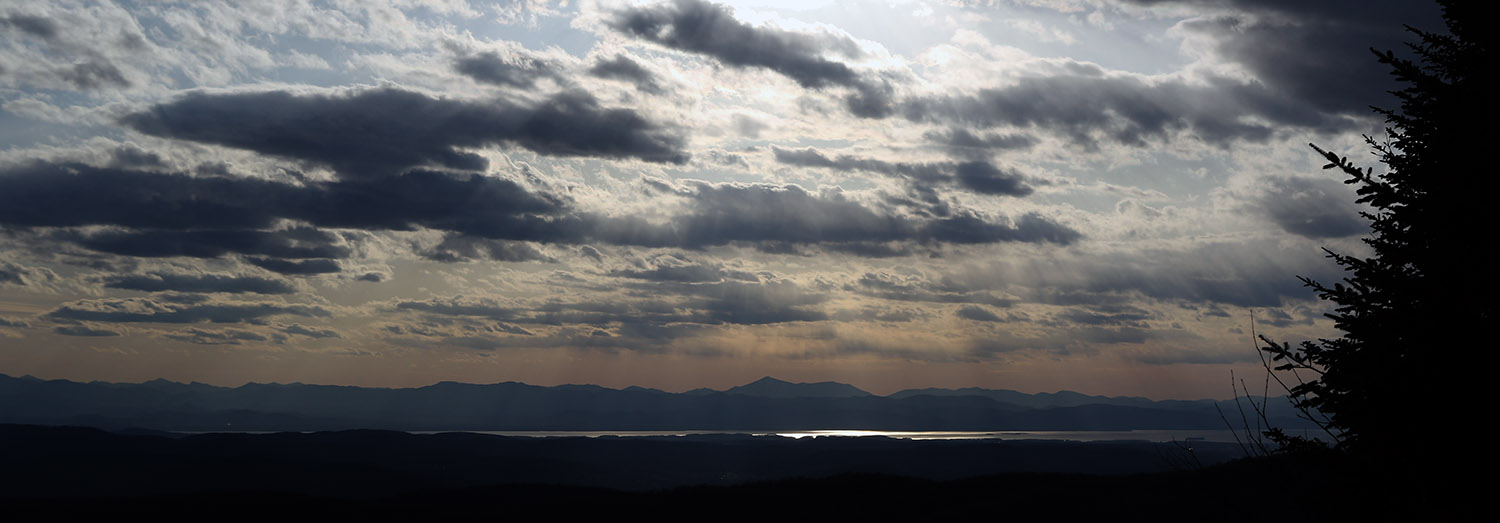 An image looking west toward Lake Champlain and the Adirondack Mountains from the Timberline Summit area at Bolton Valley Ski Resort in Vermont