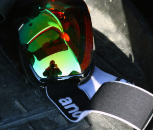 An image of ski goggles with a reflection at the end of a ski tour by the Timberline base area of Bolton Valley Resort in Vermont