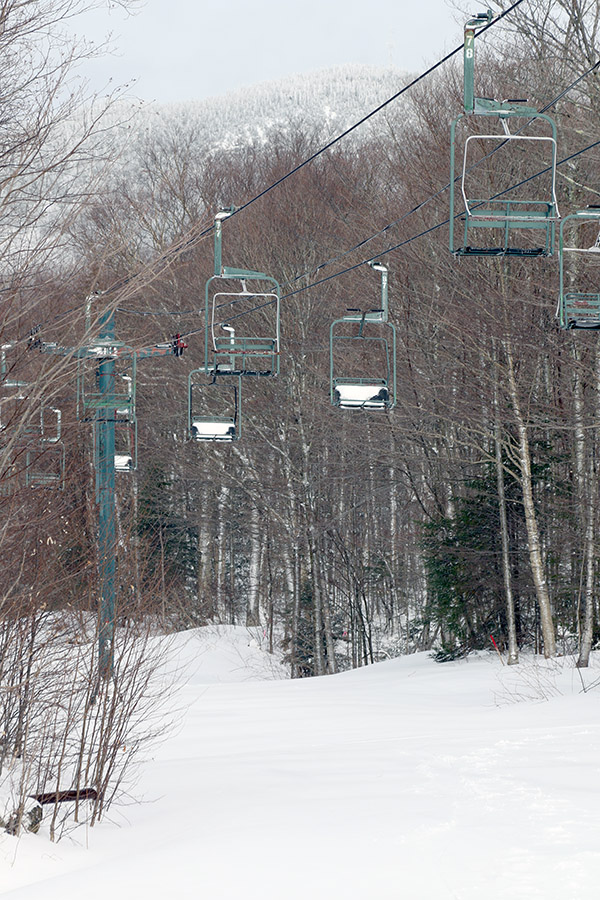 An image of the Wilderness Chairlift with a fresh coating a of April snow at Bolton Valley Ski Resort in Vermont