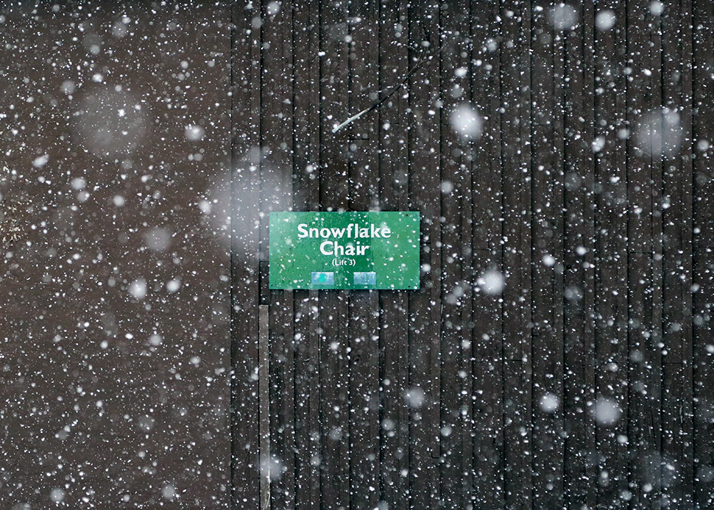 An image of snow falling at the base of the Snowflake lift during a late-April snowstorm at Bolton Valley Ski Resort in Vermont.