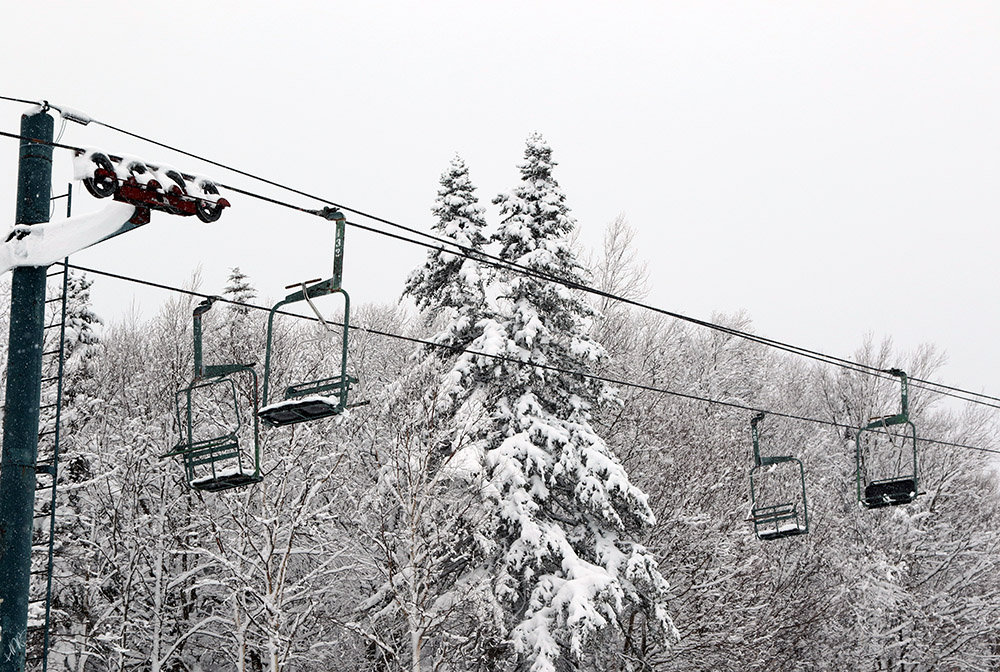 An image of the Wilderness double chairlift taken during a ski tour during a late-April snowstorm at Bolton Valley Ski Resort in Vermont
