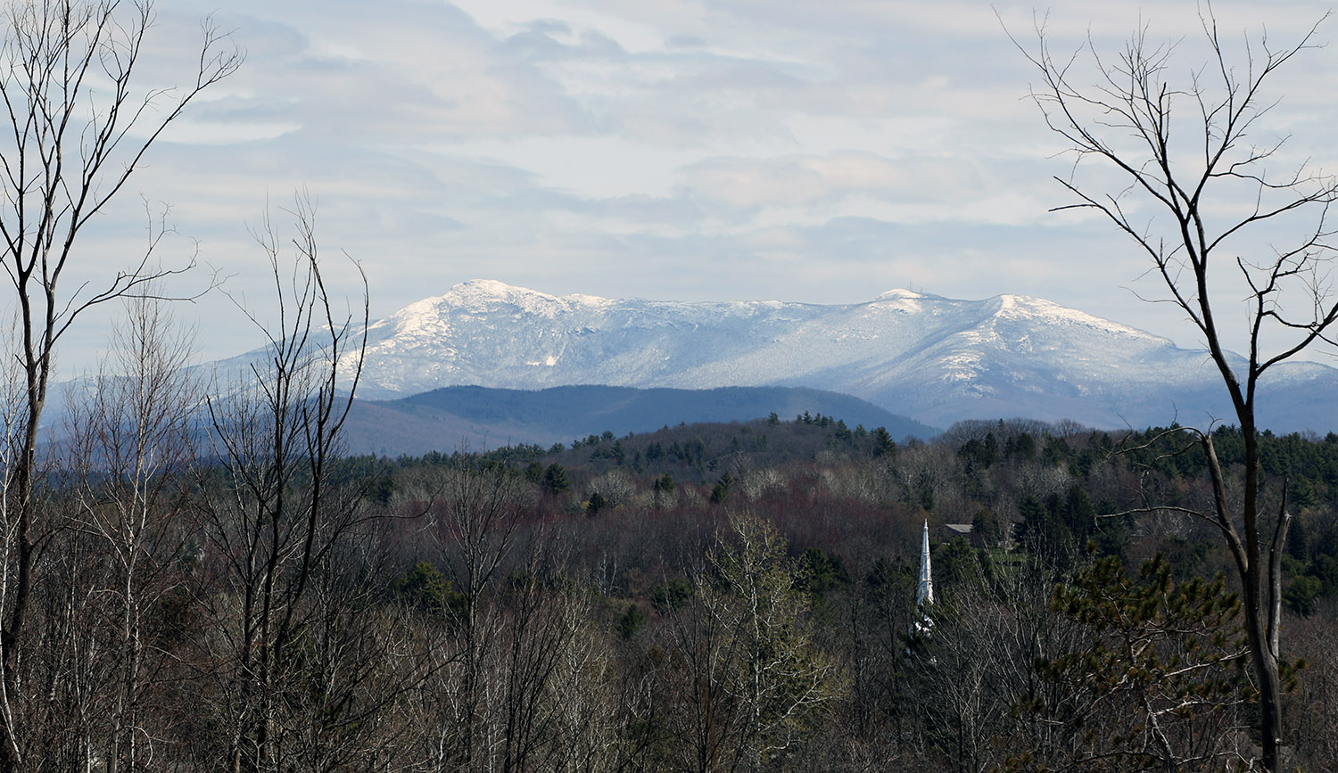 An image taken from Interstate 89 of Mount Mansfield in Vermont covered with snow after a late-April snowstorm