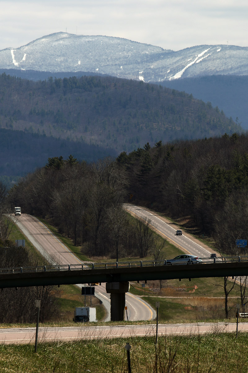 An image of Bolton Valley Ski Resort in Vermont taken from the Southbound Information Center on Interstate 89 near Williston after a late-April snowstorm
