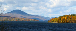 An image of foliage in the Newport, VT area along Lake Memphremagog with the mountain Owl's Head visible off in Canada.