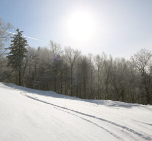 An image of a ski track in powder snow after some small storms dropped 8 to 10 inches at Bolton Valley Ski Resort in Vermont