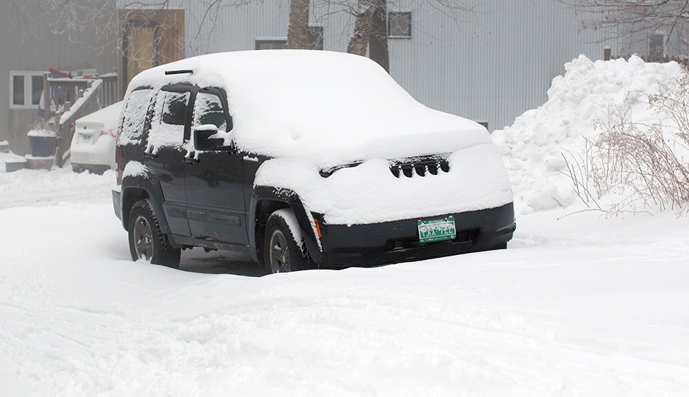 An image of a vehicle covered in snow from Winter Storm John in the Village area at Bolton Valley Ski Resort in Vermont